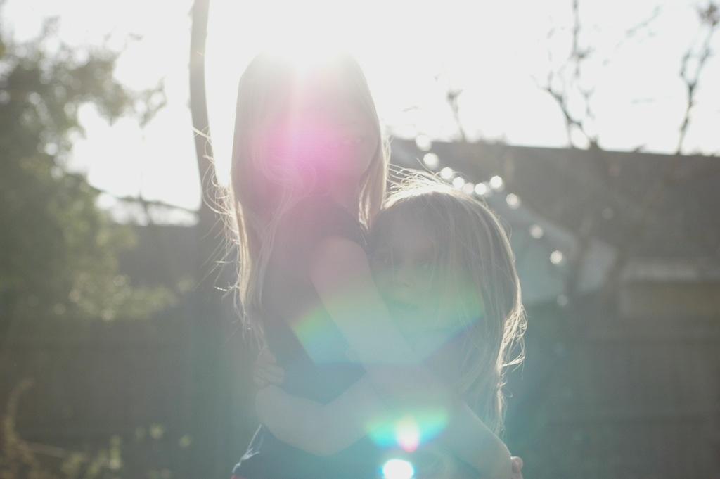 sister hugs